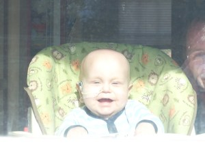 Alexander looks out the window to the world!